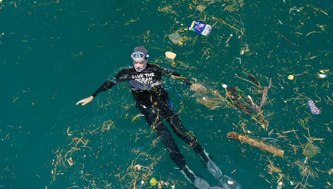 swimming in plastic polluted water