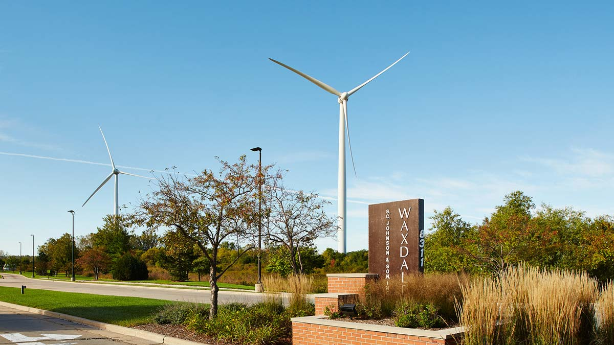 Entrance to SC Johnson Waxdale manufacturing facility with its wind turbines in the background