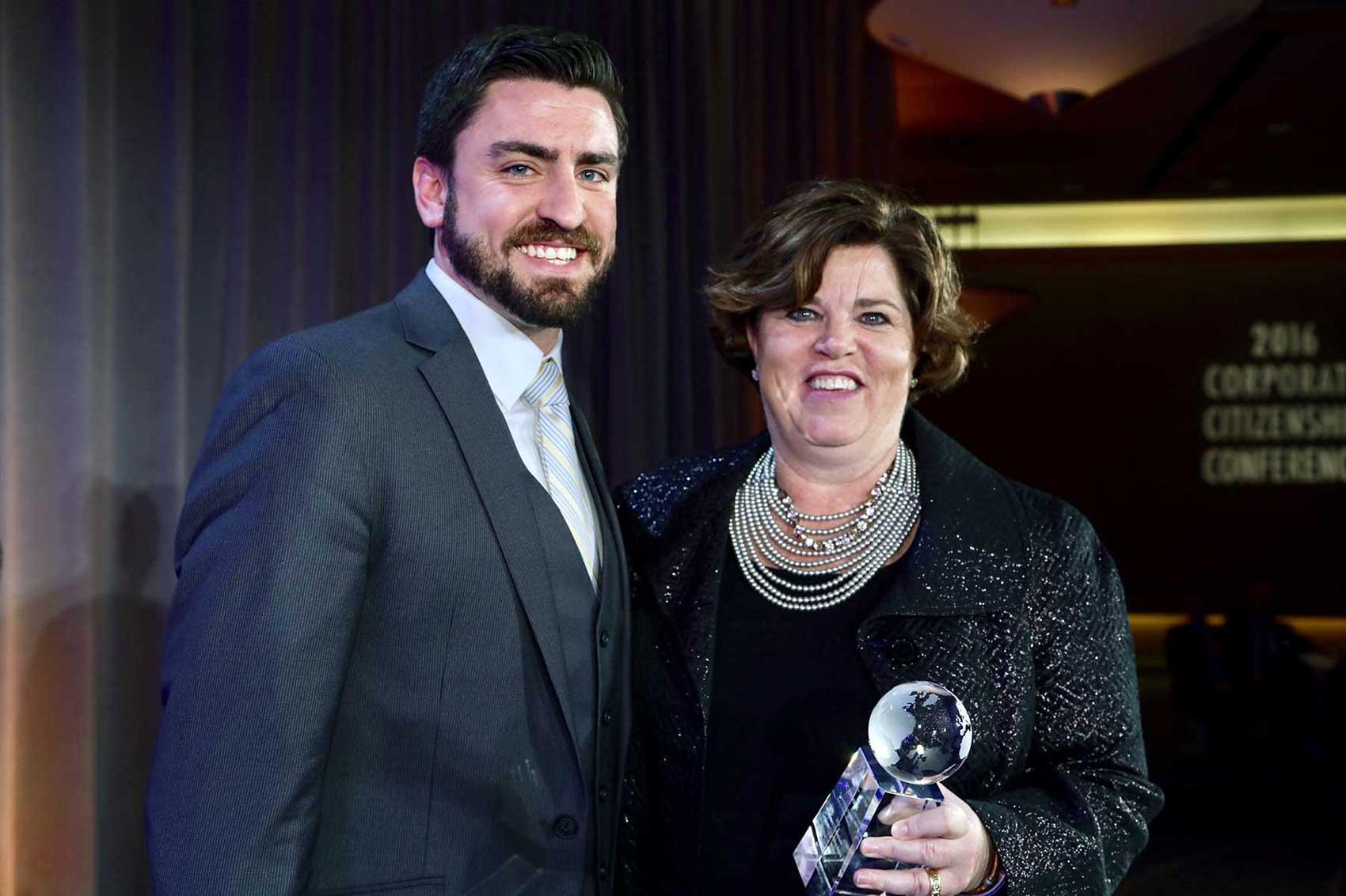 Reuben Smith-Vaughan Executive Director of AACCLA presents Kelly M. Semrau of SC Johnson the 2016 Western Hemisphere Corporate Citizenship Award