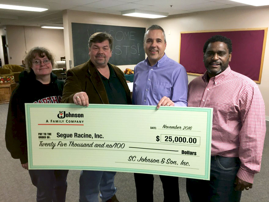 Segue Racine volunteers receive a donation from SC Johnson