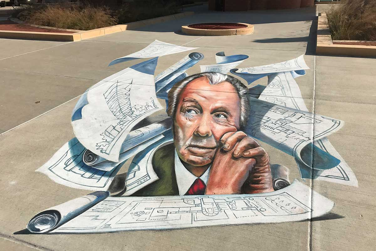 A chalk art drawing of Frank Lloyd Wright on the SC Johnson campus