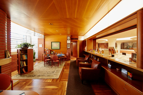 A wide view looking into H.F. Johnson, Jr.'s Frank Lloyd Wright-designed office at SC Johnson