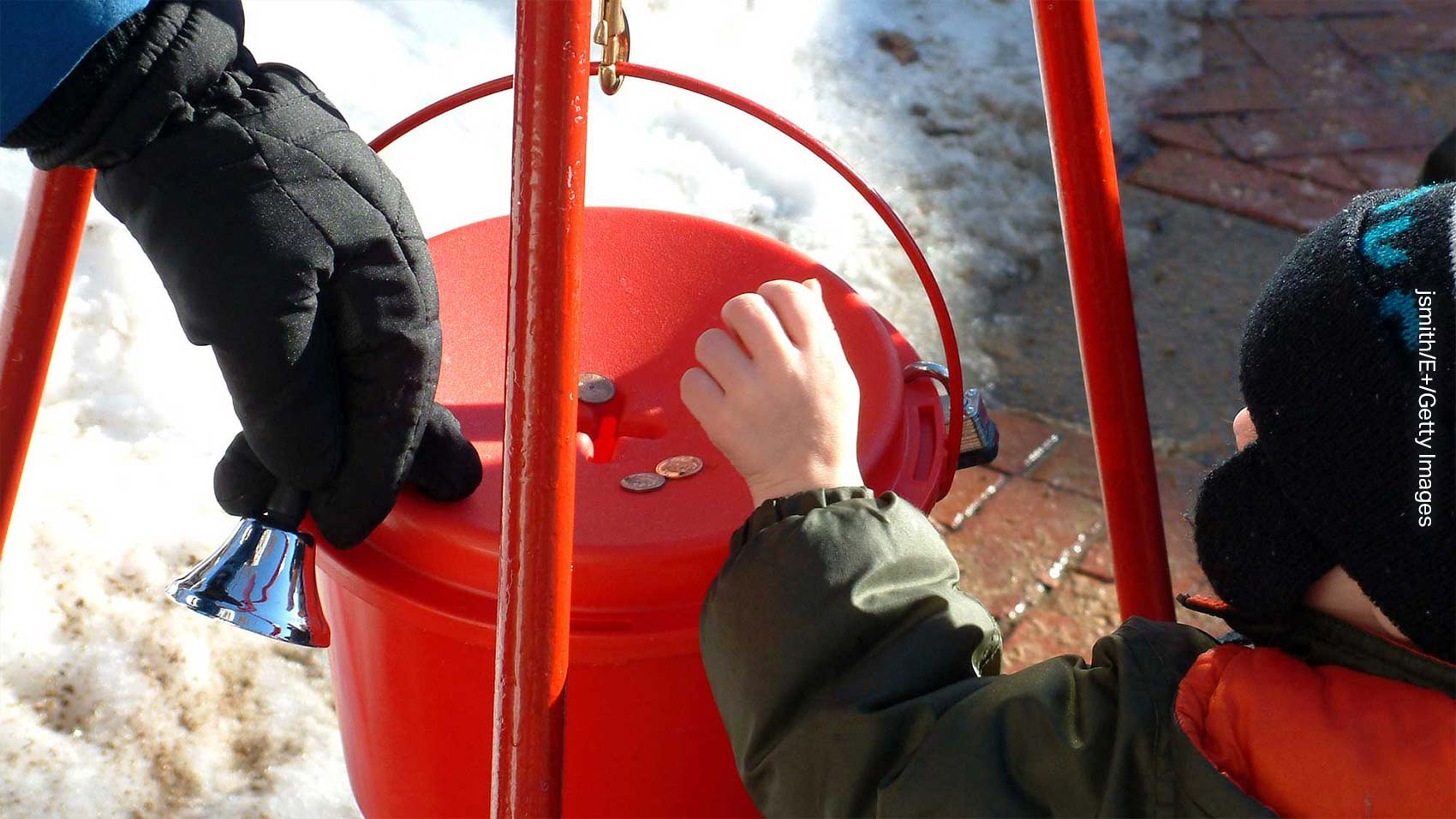 Donating at the red kettle to help others