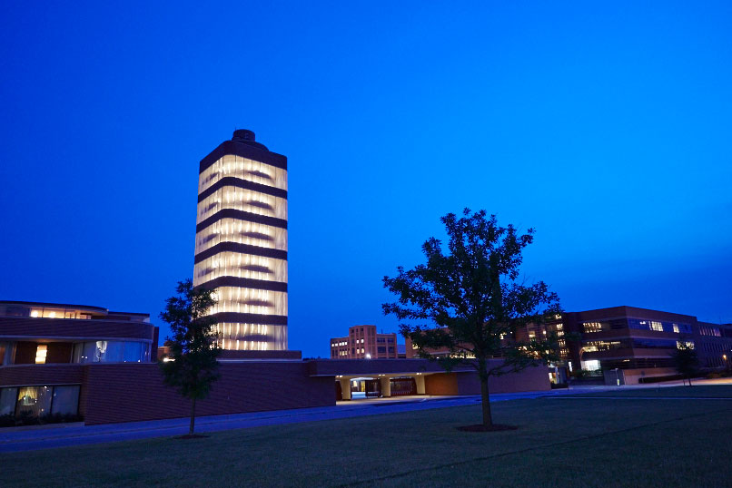 A nighttime view of the SC Johnson Research Tower designed by Frank Lloyd Wright