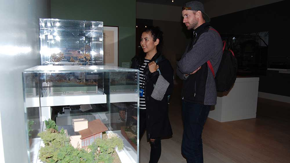 Visitors look at scale models of Frank Lloyd Wright designs during a tour of SC Johnson