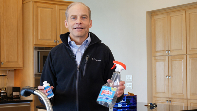 fisk johnson holding windex concentrate cleaner