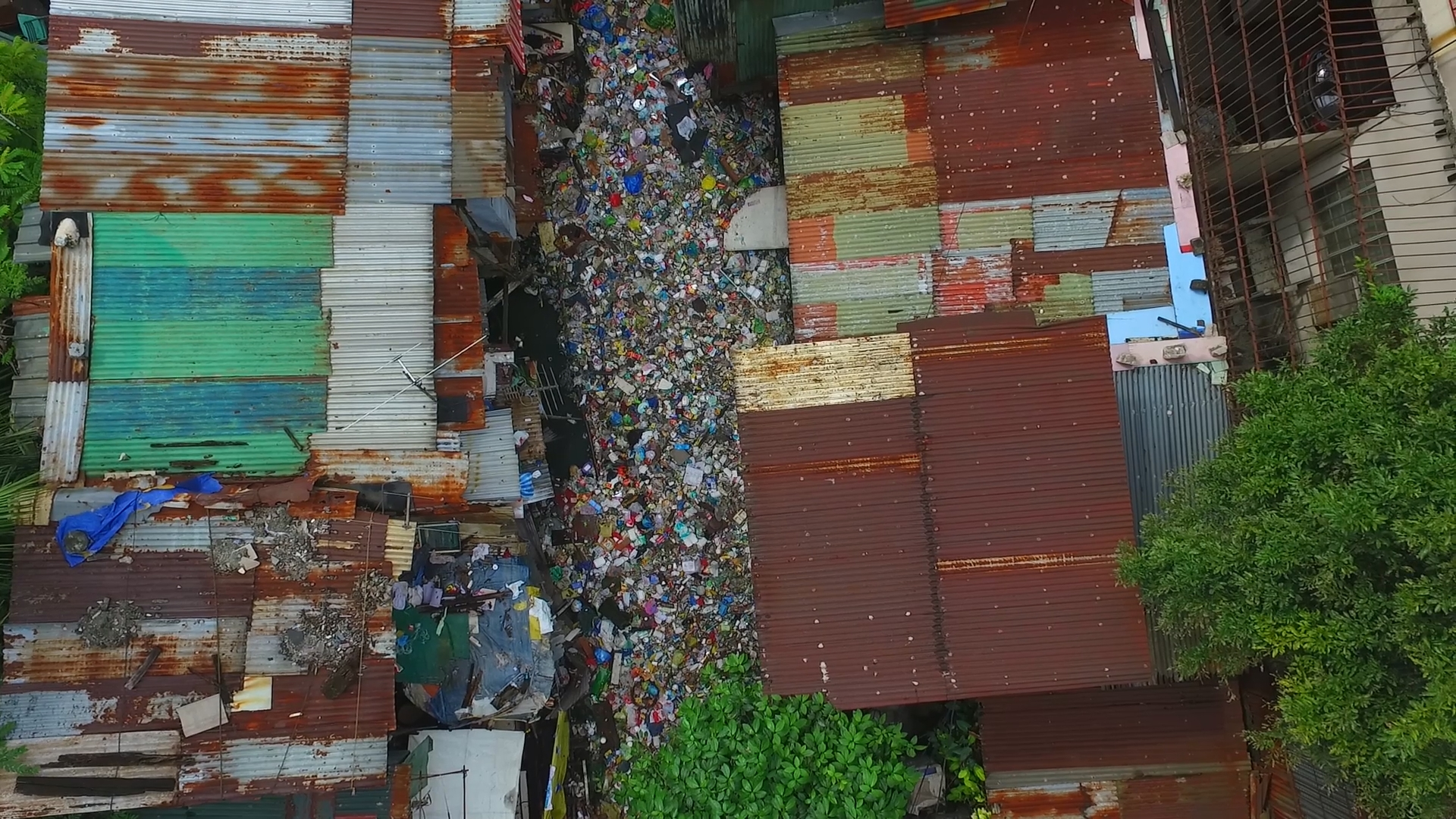 garbage completely filling a river in panama.