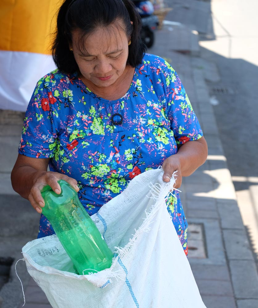 Nyoman Darti collects plastic waste in the new recycling center opened by SC Johnson and Plastic Bank in Bali Indonesia.