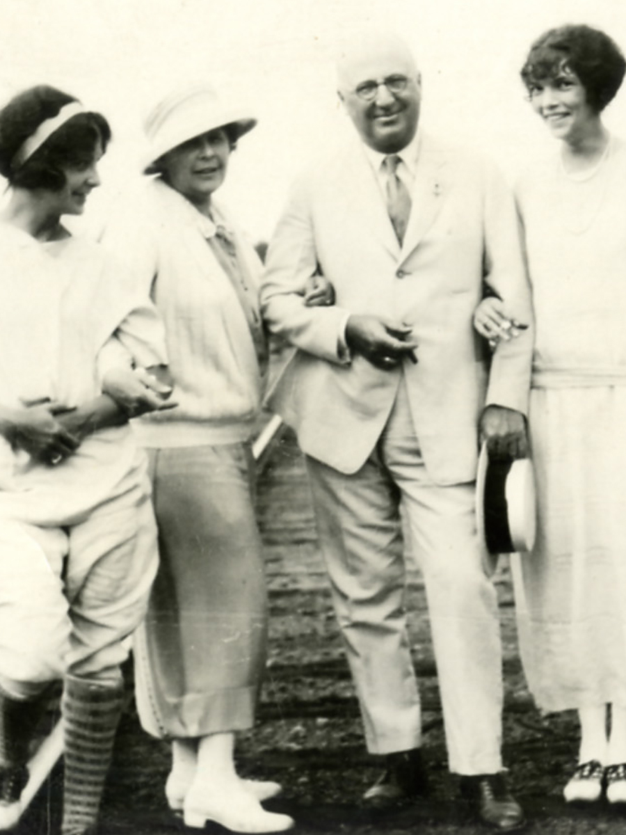 Herbert F. Johnson, Sr. standing in his white suit