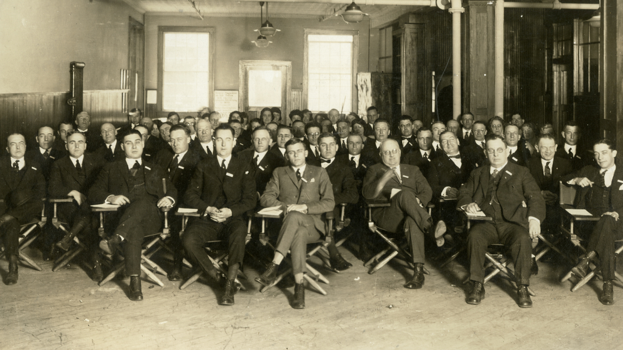 Herbert F. Johnson sitting front row at SC Johnson