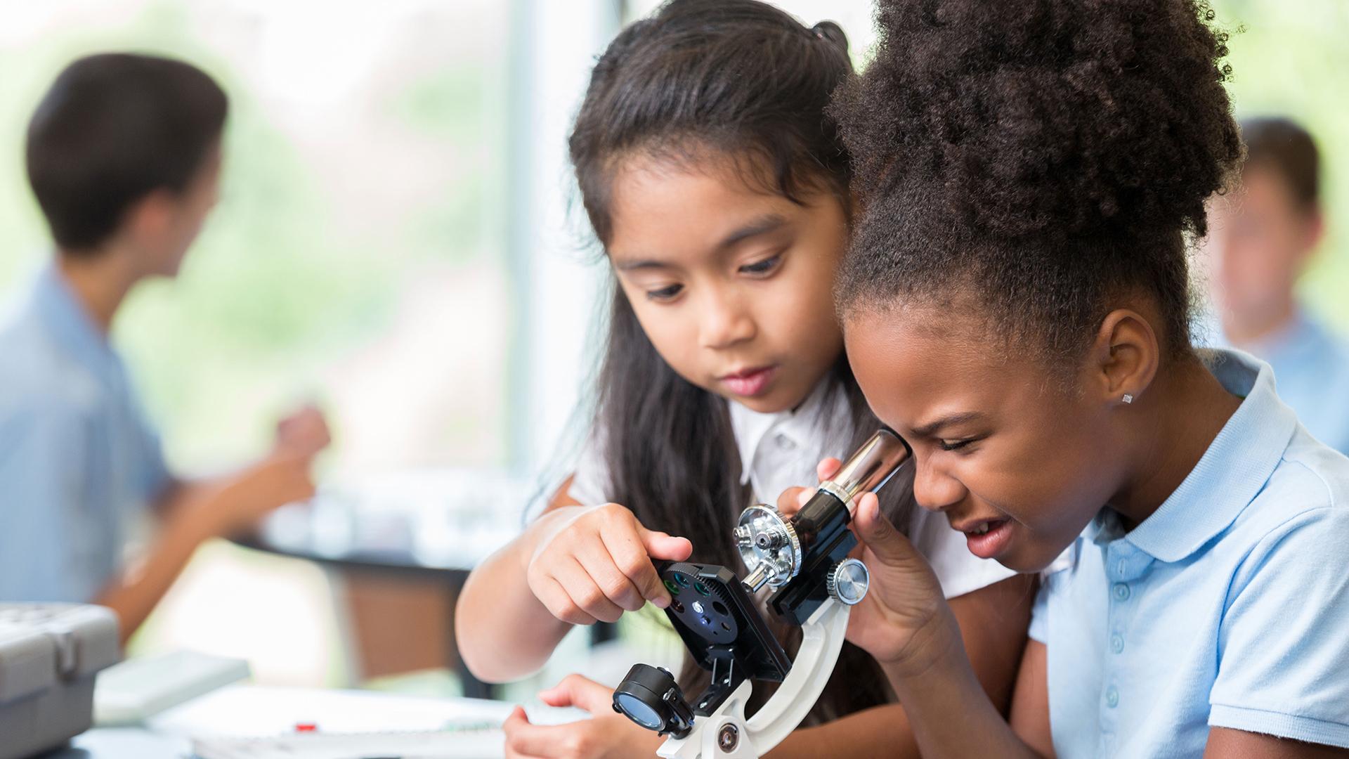 Children Looking Through Microscope