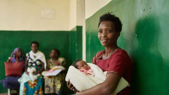 Mother and child outside one of the SC Johnson sponsored Health Clinic in Rwanda.