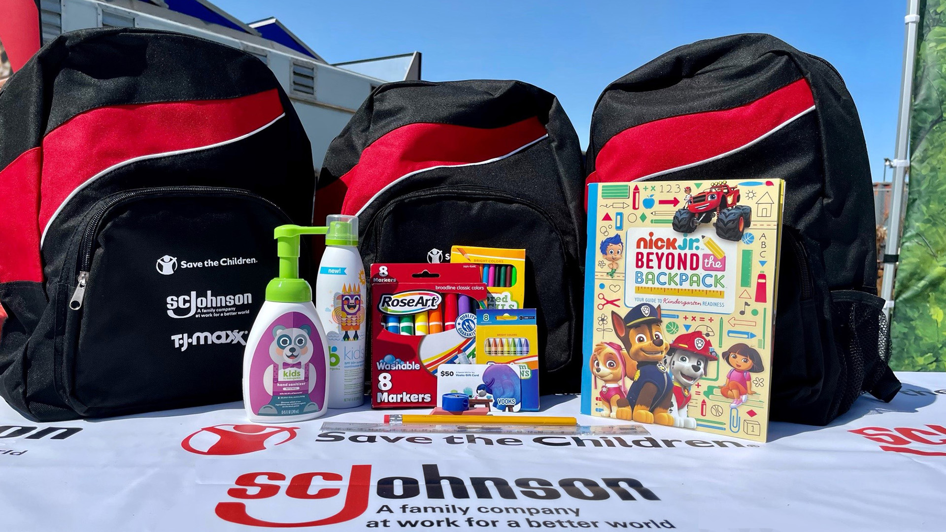 SC Johnson sponsored backpack and material on table